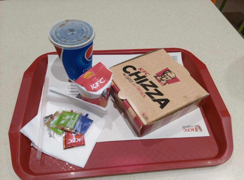 My order : KFC Chizza and Pepsi, and one Small Chicken Popcorn